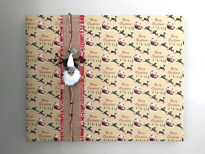 Easy to Follow Steps and Video for How to Wrap A Picture Frame with Wrapping Paper. Try this Easy DIY Christmas Decor Idea.