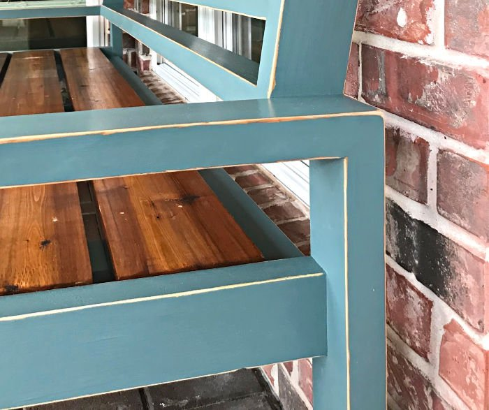Easy to follow steps for this beautiful DIY Blue Distressed Paint using petroleum jelly (Vaseline) and Magnolia Homes by Kilz paint color Demo Day. Paint an Outdoor Bench or any furniture with these steps.