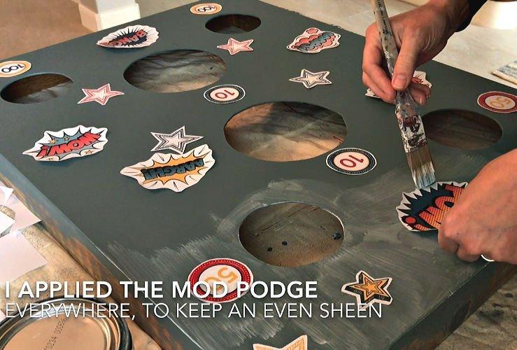 Applying the art for my DIY Nerf Gun Target with Matte Mod Podge.