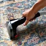 Here's How to Clean Area Rugs At Home, using a Bissell SpotClean Pro. Steps and tips for small stains and for rugs with all over dirt and stains.
