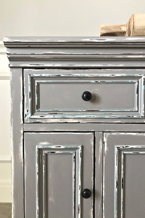 DIY Gray Distressed Chalk Paint Makeover. How to layer chalk paint colors and distress for the perfect vintage world.