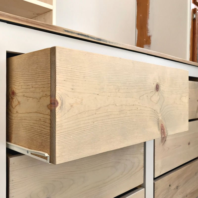 How to build Easy DIY Drawer Boxes with lumber. Simple rustic drawer design for storage and other woodworking projects. Most of the tutorials you find for building drawer boxes are for plywood boxes with a face or for high-end lumber with fancy joinery. BUT, sometimes you just want an easy, low-cost, simple drawer like this this drawer with a pretty, rustic design.